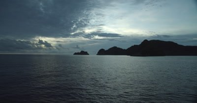 Approaching the coast of Cocos island at dawn