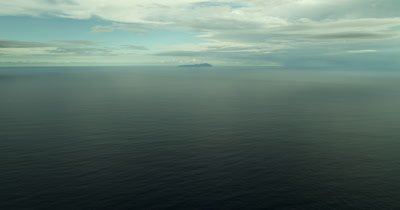 Far away island on the horizon. Slight tilt up