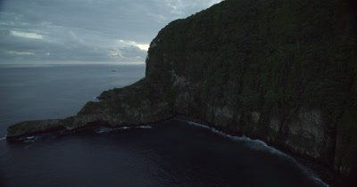 Circling around the coast of Cocos Island, past waterfall