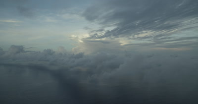 Flying by a layer of clouds over the ocean