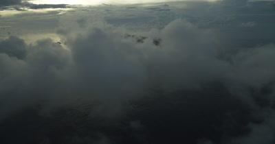 Reveal of Cocos island through clouds