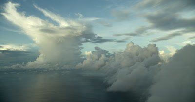 Large cloud in background hovering over ocean