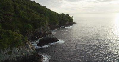 Flying around Cocos Island, coast on left side