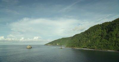 flying along coast of Cocos Island, calm, tranquil seas
