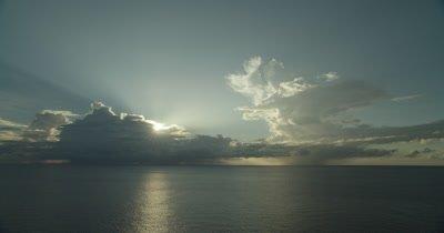 Horizon and sun peaking through clouds