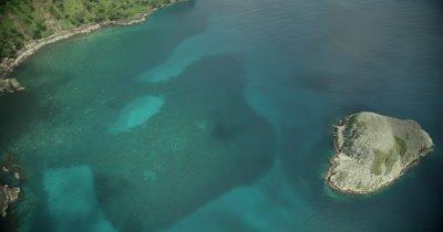 focusing on dark reef underwater, varied hue of water
