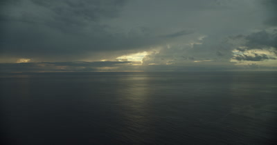 Shot of ocean and dark clouds with slight tilt