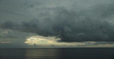 dark cloud formation over ocean