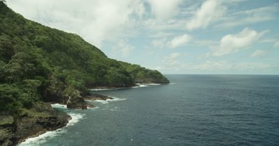 Flying along coast of island