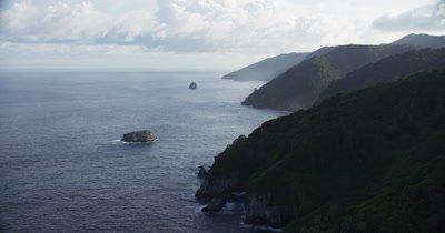 coast Cocos Island, mist surrounding edge of island