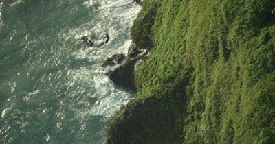 travelling along coast, waves crashing on island