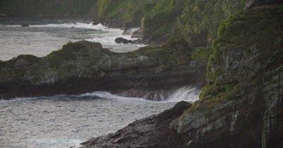 waves hitting rocks and coast of island