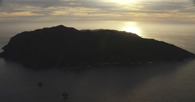 track left on island. sun behind