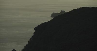 Coastline is revealed behind mountain