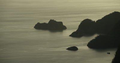 sun reflecting on ocean. panning around coast