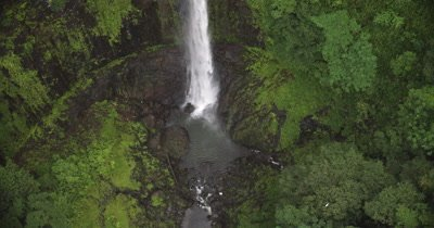 bird's eye view of waterfall spilling into small pool