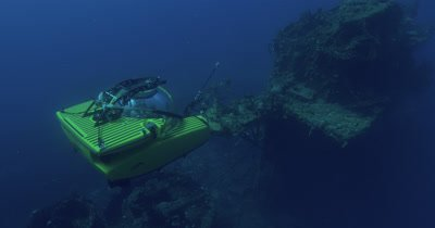 High angle of submarine and USS Saratoga wreck