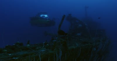Approaching and traveling up hull, reveal submarine by wreck of USS Lamson