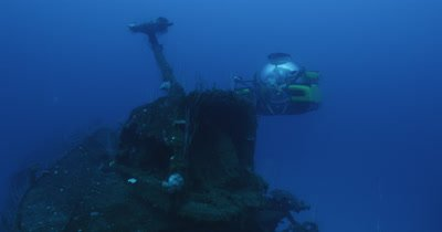 submarine illuminating wrecked ship, USS Lamson