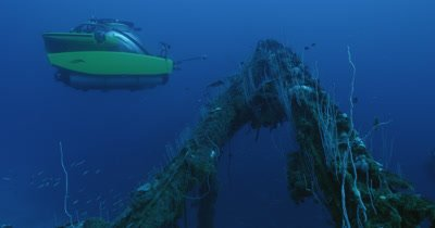 submarine traveling next to side of ship wreck, USS Lamson.