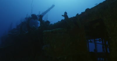 Traveling along edge of wreck at low angle, surface in background