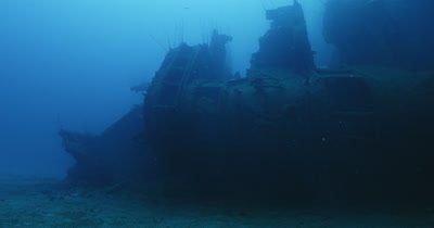 Somewhat static view of Nagato wreck lying on its side on the seabed.