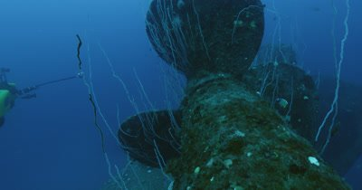 submarine traveling behind propeller of Nagato wreck