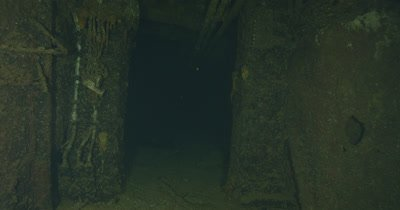 Inside wreck of USS Saratoga, traveling sideways through doors