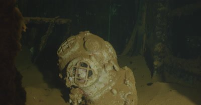 close up on old scuba diver helmet inside ship wreck. USS Saratoga