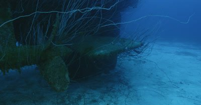 Pan from propeller, along top of wreck