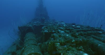 Traveling along wreck, tilt up to bridge of USS Apogon