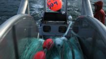 Bristol Bay Salmon Fishery - Bouy Comes Over The Rail Shot From Net Reel