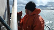 Bristol Bay Salmon Fishery - Fisherman Works Brake On Net Reel While Setting Net