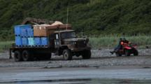 Bristol Bay Salmon Fishery - 4 Wheeler Goes By Fish Truck At Set Net Site