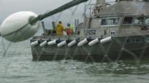 Bristol Bay Salmon Fishery - Fishermen Working On Boat, Net In Foreground