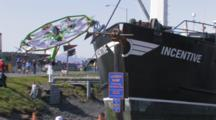 Carnival Rides Behind Ship During Kodiak Crab Festival