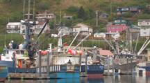 Fishing Boats Docked In Kodiak Harbor, Houses On Hill