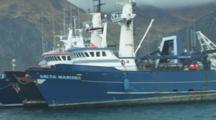 Pass By Boats Docked In Harbor, Snowy Mountains Behind, Alaska Crab Fisheries - Dutch Harbor, Alaska, Unalaska