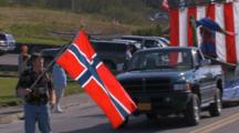 Waving Flags In Parade For Kodiak Crab Festival