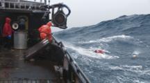 Crab Fishing Bering Sea Alaska - Fisherman Throws Hook And Runs Bouys Through Block