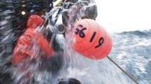 Crab Fishing Bering Sea Alaska - Fisherman Runs Bouys Through Block Hauling Crab Pot