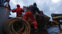 Crab Fishing Bering Sea - Fisherman Ties Up Coil Low Angle