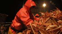 Crab Fishing Bering Sea - Fishermen Dump Crab Onto Table