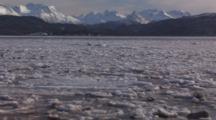 Winter Ice Floe In Current On Kachemak Bay Moves Across Frame