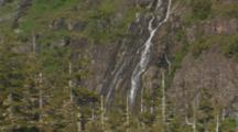 Waterfall Down Steep Wall Near Forest, Prince William Sound Alaska