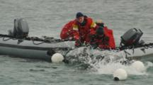 Men In Zodiacs Work With Nets, Buoys To Hold Captured Animal