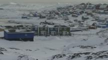 Tilt Up To Reveal Village In Rugged Snowy Area