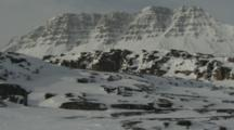 Snowy Arctic Landscape With Rugged Mountains