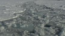View Looking Down From Boat Traveling Through Melt Ice