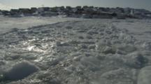 View From Boat Traveling Through Melt Ice Leaving Village